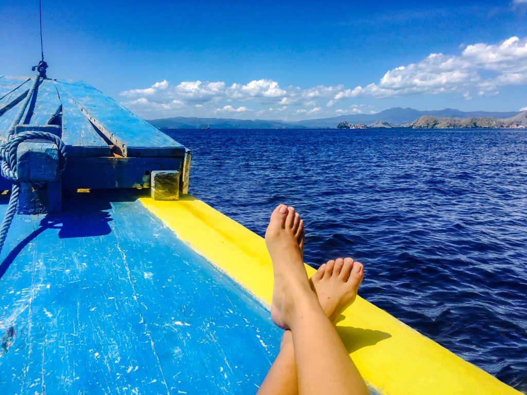 Solo female traveler on a boat trip to the Komodo Island, Indonesia